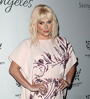 Kesha celebrates the return of stolen custom jacket