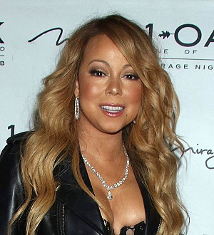 Mariah Carey launches sexy shirtless circus at docu-series press conference