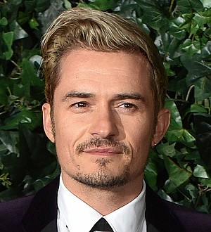 Orlando Bloom teaches drama masterclass at British high school