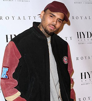 Authorities begin searching Chris Brown's home