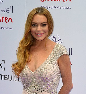 Lindsay Lohan takes on ISIS terrorists by penning poem