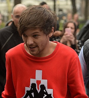 Louis Tomlinson leaves fans guessing with new 'E' tattoo