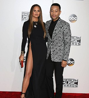 John Legend: 'Snapper was in wrong place at wrong time for my wife's wardrobe malfunction'