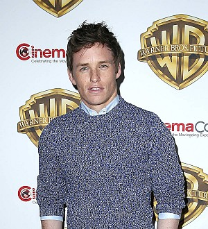 Eddie Redmayne performs magic trick with Benedict Cumberbatch