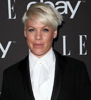Pink narrowly escapes fall on treadmill