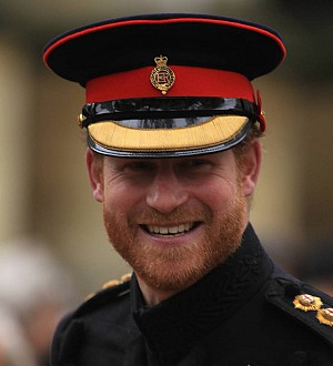 Prince Harry honors British war pilot with Christmas cards