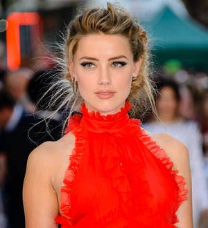 Amber Heard issued with summons in Australia for importing dogs