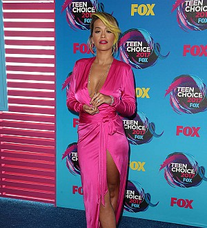 Rita Ora presents reality show while wearing foot cast