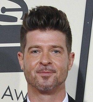 Robin Thicke loses custody of son amid family court battle with ex Paula Patton