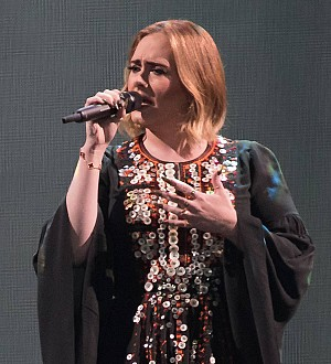 Adele invites herself to gay fans' wedding