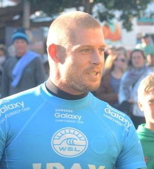 Surfer Mick Fanning attacked by shark on live TV