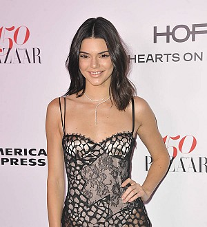 Kendall Jenner blocks out family when walking the runway
