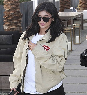 Kylie Jenner locks lips with rumoured beau in music video