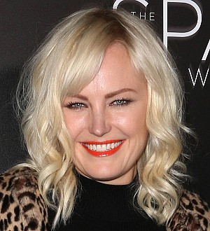 Malin Akerman got to know Jamie Dornan very well during risque modeling shoot