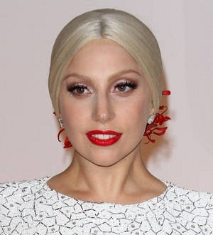 Lady Gaga drinks wine to numb the pain of bleaching her hair