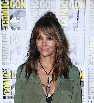 Halle Berry downs bourbon with Channing Tatum during Comic-Con panel