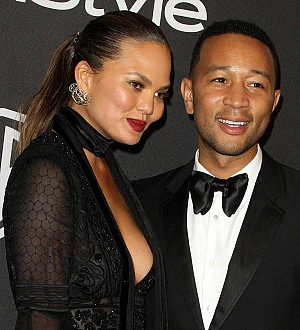 Chrissy Teigen disgusted by racist photographer