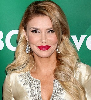 Brandi Glanville posts racy snap after being 'blackmailed'