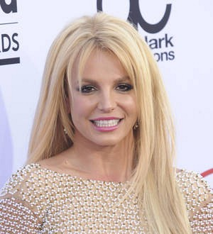 Britney Spears paints topless to Mariah Carey's music