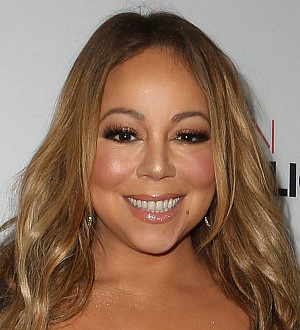 Mariah Carey using music as therapy after break-up
