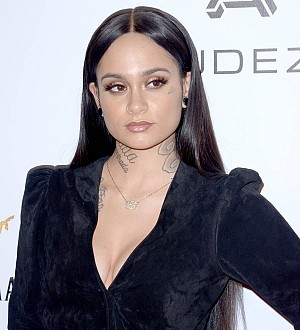 Kehlani boots fan from concert for hurling insult