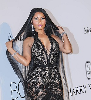 Nicki Minaj sizzles in a lacy black dress at amfAR gala