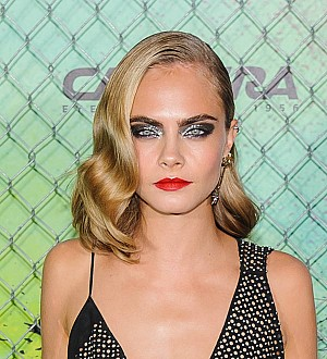 Cara Delevingne raised to keep 'weak' emotions under wraps