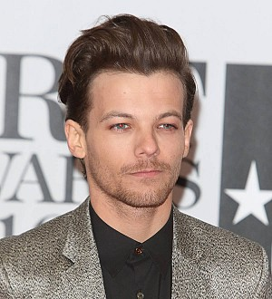 Louis Tomlinson irate over girlfriend's topless photos