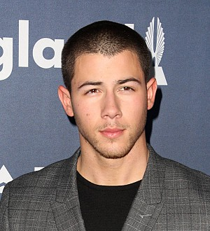 Nick Jonas laughs off guitar solo mess at ACM Awards