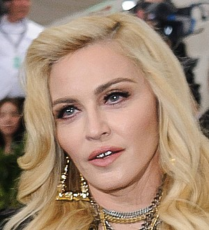 Madonna accepts damages over article published about twin girls
