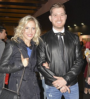 Michael Buble and wife take turns working