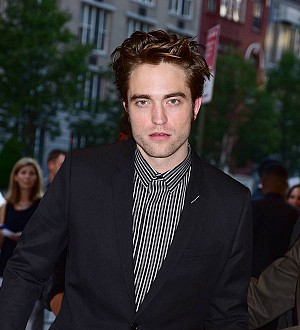 Robert Pattinson turned to therapy to help him cope with fame