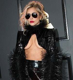 Lady Gaga goes public with new romance at Grammys afterparty