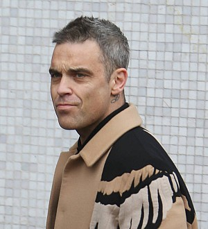 Robbie Williams urges everyone to drink coffee and 'breed'