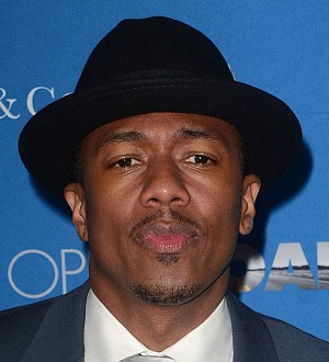 Nick Cannon blames visitation issues for divorce delay
