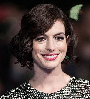 Anne Hathaway shows off bump in bikini picture