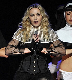Madonna performs with Nelly Furtado