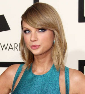 Taylor Swift brings John Legend, Beck and St. Vincent onstage
