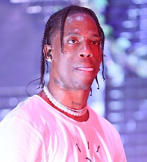Travis Scott pleads not guilty to riot charge