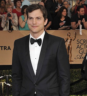 Ashton Kutcher surprises high school students in hometown for charity