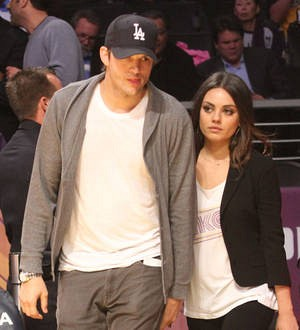 Ashton Kutcher and Mila Kunis wed in luxury secret garden