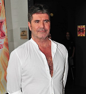 Simon Cowell praised for organising 'beautiful' charity single after Grenfell Tower blaze