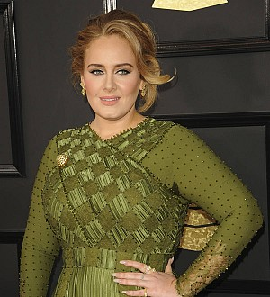 Adele shares a cup of tea and cuddle with Grenfell Tower firefighters