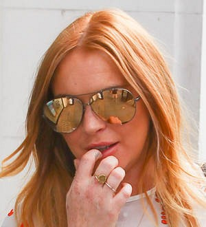 Lindsay Lohan and her brother want former associate jailed