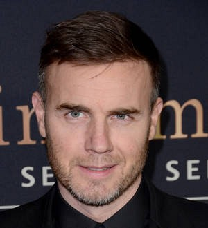 Gary Barlow makes fan's wedding dreams come true with surprise visit