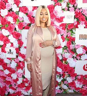 Glowing Blac Chyna cradles newborn Dream in Snapchat video