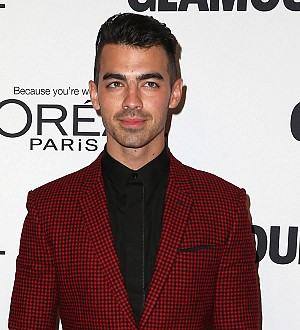 Joe Jonas and Charlotte McKinney strip down for Guess campaign