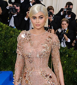 Kylie Jenner models see-through dresses for racy shoot