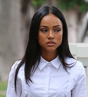 Karrueche Tran fires back after Chris Brown associate makes gun threat