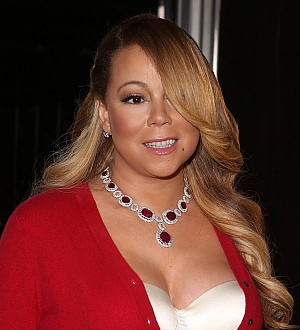 Mariah Carey showcases chemistry with Bryan Tanaka at holiday lighting ceremony